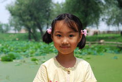 Asian little girl In summer park stock photos