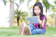 Asian little girl with a Tablet Stock Image