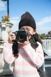 Asian little girl taking photo by shooting camera with happiness. Concept for holiday travel Royalty Free Stock Image