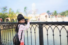 Asian little girl taking photo by shooting camera with happiness. Concept for holiday travel Stock Image