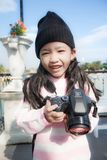 Asian little girl taking photo by shooting camera with happiness. Concept for holiday travel Stock Photography