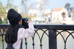 Asian little girl taking photo by shooting camera with happiness. Concept for holiday travel Royalty Free Stock Photography