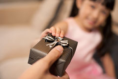 Asian Little Girl taking a present royalty free stock images