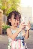 Asian little girl taking a selfie Royalty Free Stock Photos
