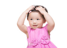 Asian little girl two hand touch her hair Stock Photography