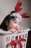 Asian  little girl wearing a reindeer headband Royalty Free Stock Photos