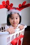 Asian little girl wearing a reindeer headband Stock Images