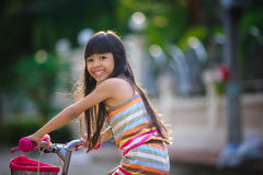 Asian Little Girl With Her Bicycle Royalty Free Stock Image