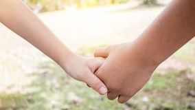 Asian little girls holding hands couple together show Relationsh Royalty Free Stock Photo