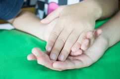 Asian little girls holding hands couple together show Relationsh. Ip between sister and familay, Love parents friendship concept, green background Stock Photography