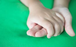 Asian little girls holding hands couple together show Relationsh. Ip between sister and familay, Love parents friendship concept, green background Royalty Free Stock Photography