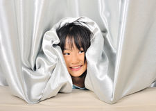 Asian Little kid peeking out from a curtain Royalty Free Stock Photo