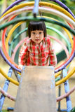 Asian little kid playing in the amusement park Stock Images