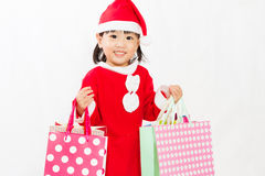 Asian Little Santa Claus with shopping bag Royalty Free Stock Photo