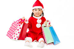 Asian Little Santa Claus with shopping bag Stock Photo