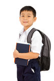 Asian Little School Boy Holding Books with Backpack on White Bac. Kground Stock Photography