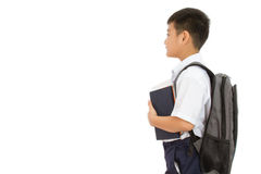 Asian Little School Boy Holding Books with Backpack. On White Background Stock Photo