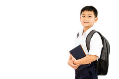 Asian Little School Boy Holding Books with Backpack. On White Background Stock Photography