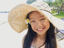 Asian long black hair girl is wearing straw hat and white flower Royalty Free Stock Photos