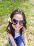 Asian long black hair girl is wearing black sunglasses and white royalty free stock photo