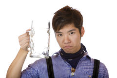 Asian look sad, with empty Oktoberfest beer stein Royalty Free Stock Image