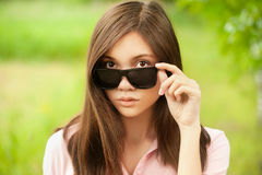 Asian looking over sunglasses Stock Images