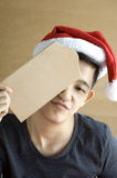 Asian looks holding blank board with boring face Stock Photography