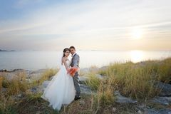 Asian love couples in pre wedding photography. Asian love couples in pre wedding photography,Location Sichang Island Attractions in chonburi,Thailand Royalty Free Stock Image