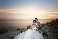 Asian love couples in pre wedding photography. Asian love couples in pre wedding photography,Location Sichang Island Attractions in chonburi,Thailand Royalty Free Stock Photos