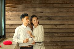Asian Lover man and woman enjoy with cup of coffee in coffee s royalty free stock photos