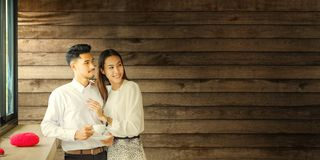 Asian Lover man and woman enjoy with cup of coffee in coffee s royalty free stock photography