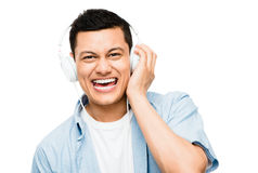 Asian lsitening to music  Royalty Free Stock Photo