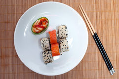 Asian lunch. (plate of sushi on the makisu Stock Image