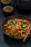 Asian lunch. Buckwheat noodles with seafood, vertical, closeup. Asian lunch. Buckwheat noodles with seafood, closeup royalty free stock images