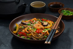 Asian lunch. Buckwheat noodles with seafood, closeup Royalty Free Stock Photography