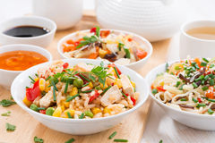 Asian lunch - fried rice with tofu, noodles with vegetables Royalty Free Stock Image
