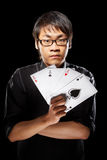 Asian magician with cards Stock Photos
