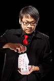 Asian magician with cards Stock Photography