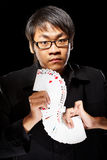 Asian magician with cards Royalty Free Stock Image