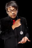 Asian magician with pendulum Royalty Free Stock Photos