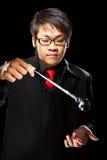 Asian magician with pendulum Stock Image