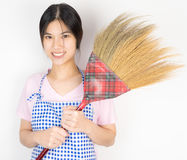 Asian Maid holding a broom Stock Image