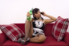 Asian maid holds spray bottle Royalty Free Stock Image