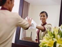 Asian maid working in hotel room and smiling Royalty Free Stock Images