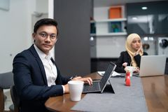 Free Asian Malay Couple Having A Coffee In Pantry Office Stock Images - 123950694