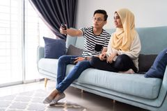 Asian malay couple having a coffee in pantry office royalty free stock photo