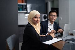 Free Asian Malay Couple Working Together At Home Stock Image - 123950671