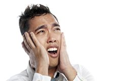 Asian Malay frowning in pain and agony Stock Images