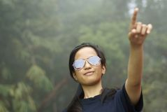 Asian malay girl pointing up Royalty Free Stock Photo