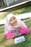 Asian Malay Muslim woman reading Royalty Free Stock Images